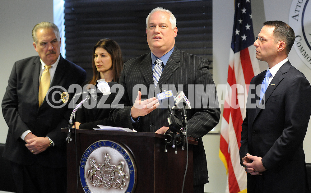 Bucks County District Attorney Matt Weintraub (center) and Pennsylvania Attorney General Josh Shapiro (right) speak with the media after 5 arrests in a child sexual predator ring during a news conference announcing the arrests of Sunday, January 29, 2017 in Warminster, Pennsylvania. (WILLIAM THOMAS CAIN / For The Philadelphia Inquirer)