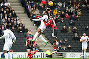 Milton Keynes Dons midfielder Chuks Aneke (25) heads the ball during the EFL Sky Bet League 1 match between Milton Keynes Dons and Shrewsbury Town at stadium:mk, Milton Keynes, England on 25 February 2017. Photo by Dennis Goodwin.
