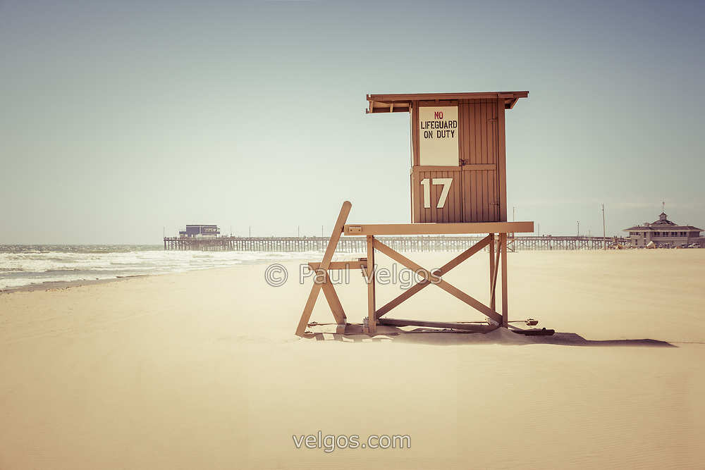 Newport Beach Pier and lifeguard tower 17 in Orange County Southern California. Copyright ⓒ Paul Velgos with All Rights Reserved.
