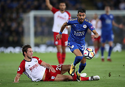 Leicester City's Riyad Mahrez is challenged by West Bromwich Albion's Grzegorz Krychowiak during the Premier League match at the King Power Stadium, Leicester.