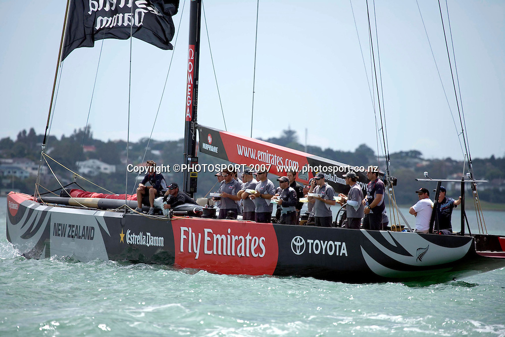Emirates Team New Zealand crew members watch their regular skipper Dean Barker during day 2 of the Auckland Match Racing Championships held on Auckland Harbour, New Zealand, on Thursday 25 January 2007. Photo: Gareth Cooke/PHOTOSPORT  <br /> <br /> <br /> <br /> 250107