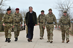 © Licensed to London News Pictures. 09/03/2012. Copedown Hill, UK. (Left to right) David Richards (black hat), Chief of Defence Staff, Philip Hammond (dark clothing), Secretary of Defence and Brigadier Doug Chalmers (second from right).  Secretary of Defence Philip Hammond visits troops who are being deployed to Afghanistan next month. The 12th Mechanized Brigade (12 Mech Bde) at Copehill Down, Salisbury Plain Training Area, Wiltshire, on FRIDAY 09 MARCH 2012, as it prepares to deploy to Helmand Province, Afghanistan, on Operation Herrick 16, in the Spring of this year. The Brigade were performing a dynamic demonstration of combined Afghan/ISAF operations supported by surveillance assets and casualty evacuation capability. Tornado GR4 fast jest ground support was also displayed.. Photo credit : Stephen SImpson/LNP