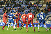 Craig Morgan (Wigan) heads the  winner in injury time, 3-2 during the Sky Bet League 1 match between Wigan Athletic and Gillingham at the DW Stadium, Wigan, England on 7 January 2016. Photo by Mark P Doherty.