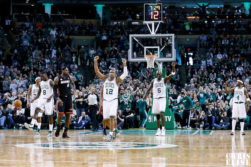 27 January 2013: Boston Celtics shooting guard Leandro Barbosa (12), Boston Celtics power forward Jeff Green (8), Boston Celtics power forward Kevin Garnett (5) and Boston Celtics shooting guard Jason Terry (4) celebrate during the Boston Celtics 100-98  2OT victory over the Miami Heat at the TD Garden, Boston, Massachusetts, USA.