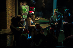 """© Licensed to London News Pictures . 16/12/2017. Manchester, UK. People socialise at a club on Deansgate Locks . Revellers out in Manchester City Centre overnight during """" Mad Friday """" , named for historically being one of the busiest nights of the year for the emergency services in the UK . Photo credit: Joel Goodman/LNP"""