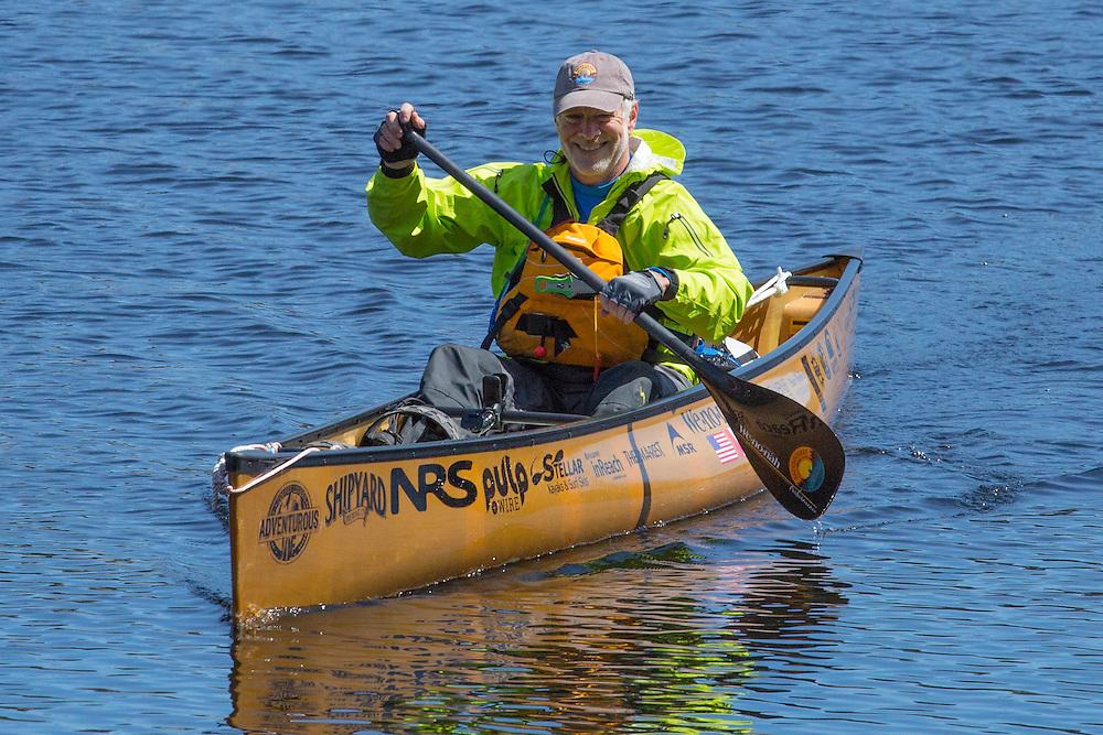 Thru-Paddler John Connelly paddles on Lake Flower in Saranac Lake, New York.