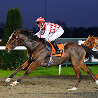 Spellmaker and E J Walsh winning the 4.05 race