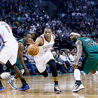 23 November 2012: Oklahoma City Thunder point guard Russell Westbrook (0) drives past Boston Celtics point guard Rajon Rondo (9) and Boston Celtics power forward Chris Wilcox (44) during the Boston Celtics 108-100 victory over the Oklahoma City Thunder at the TD Garden, Boston, Massachusetts, USA.