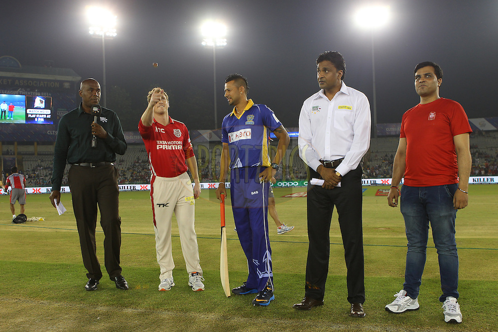 George BAILEY (Captain) of the Kings XI Punjab  and Rayad EMRIT (Captain) at the toss during match 5 of the Oppo Champions League Twenty20 between the Kings XI Punjab and the Barbados Tridents held at the Punjab Cricket Association Stadium, Mohali, India on the 20th September 2014<br /> <br /> Photo by:  Ron Gaunt / Sportzpics/ CLT20<br /> <br /> <br /> Image use is subject to the terms and conditions as laid out by the BCCI/ CLT20.  The terms and conditions can be downloaded here:<br /> <br /> http://sportzpics.photoshelter.com/gallery/CLT20-Image-Terms-and-Conditions-2014/G0000IfNJn535VPU/C0000QhhKadWcjYs
