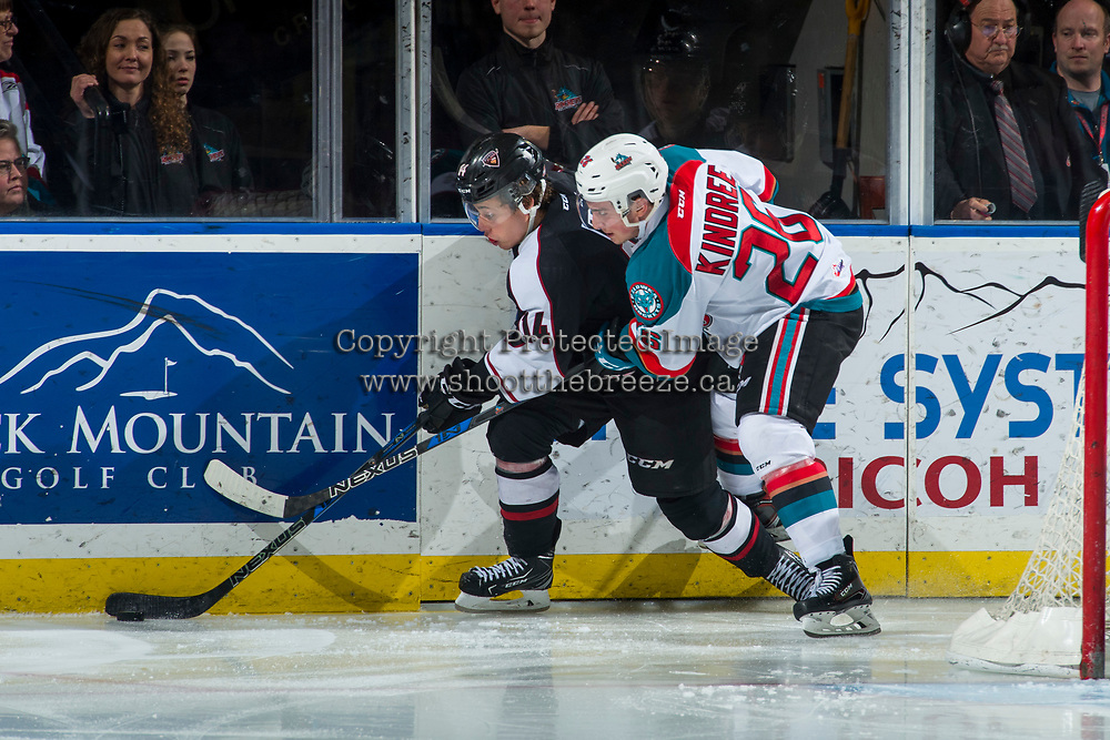 KELOWNA, CANADA - MARCH 7: Liam Kindree #26 of the Kelowna Rockets checks James Malm #14 of the Vancouver Giants  on March 7, 2018 at Prospera Place in Kelowna, British Columbia, Canada.  (Photo by Marissa Baecker/Shoot the Breeze)  *** Local Caption ***