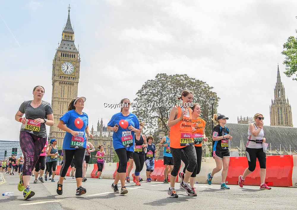 Runners in Parliament Square with Big Ben in the background. The Vitality London 10,000, Monday 29th May 2017.<br /> <br /> Photo: Thomas Lovelock for The Vitality London 10,000<br /> For further information: media@londonmarathonevents.co.uk