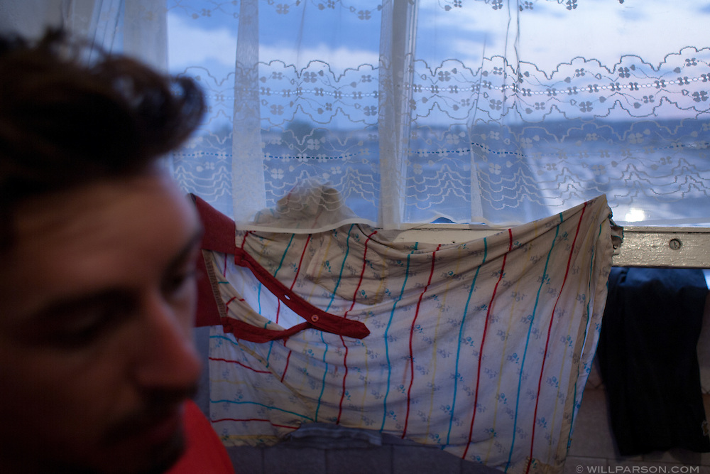 Ryan dries his shirt on a hotel room window in Rezekne, Latvia, during the two-week delay crossing into Russia. Ryan's forehead is swollen from an insect bite.