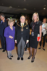 The Deputy Lord Mayor of Westminster COUNCILLOR DR CYRIL NEMETH with his wife LUCILLE (left) and SARAH PERCY-DAVIS Chief Executive of LAPADA at a preview evening of the annual London LAPADA (The Association of Art & Antiques Dealers) antiques Fair held in Berkeley Square, London on 18th September 2012.