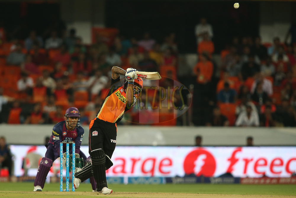Shikhar Dhawan of Sunrisers Hyderabad hits over the top for a boundary during match 22 of the Vivo IPL 2016 (Indian Premier League) between the Sunrisers Hyderabad and the Rising Pune Supergiants held at the Rajiv Gandhi Intl. Cricket Stadium, Hyderabad on the 26th April 2016<br /> <br /> Photo by Shaun Roy / IPL/ SPORTZPICS