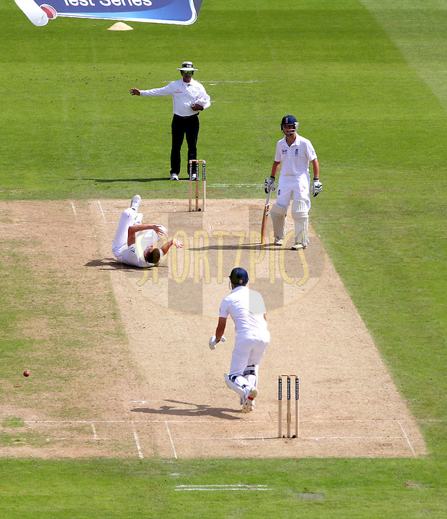 © Andrew Fosker / Seconds Left Images 2012 - South Africa's Morne Morkel rolls over as he falls while bowling from the pavilion end   England v South Africa - 1st Investec Test Match -  Day 1 - The Oval  - London - 19/07/2012