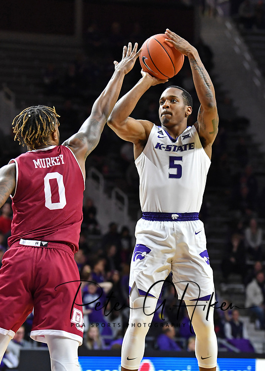 MANHATTAN, KS - NOVEMBER 12:  Barry Brown Jr. #5 of the Kansas State Wildcats puts up a shot against Ade Murkey #0 of the Denver Pioneers during the second half on November 12, 2018 at Bramlage Coliseum in Manhattan, Kansas.  (Photo by Peter G. Aiken/Getty Images) *** Local Caption *** Barry Brown Jr.; Ade Murkey