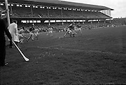 16/04/1967<br /> 04/16/1967<br /> 16 April 1967<br /> National Hurling League: Clare v Dublin at Croke Park, Dublin. <br /> J. Smyth passes the ball to N. Jordan as he is tackled by a Dublin full-back.