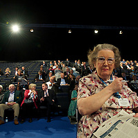 A delegate works on the crossword puzzle during speeches in the Conservatives Party Conference at Manchester Central.