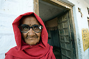 Portrait of an old Rajasthani widow wearing new spactacles (Jodhpur, Rajasthan, India)