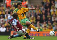 Photo. Daniel Hambury.Digitalsport<br /> Barclays Premiership.    <br /> Norwich City v Aston Villa.<br /> 18/09/2004.<br /> Norwich City's Youssef Safri and Aston Villa's Darius Vassell