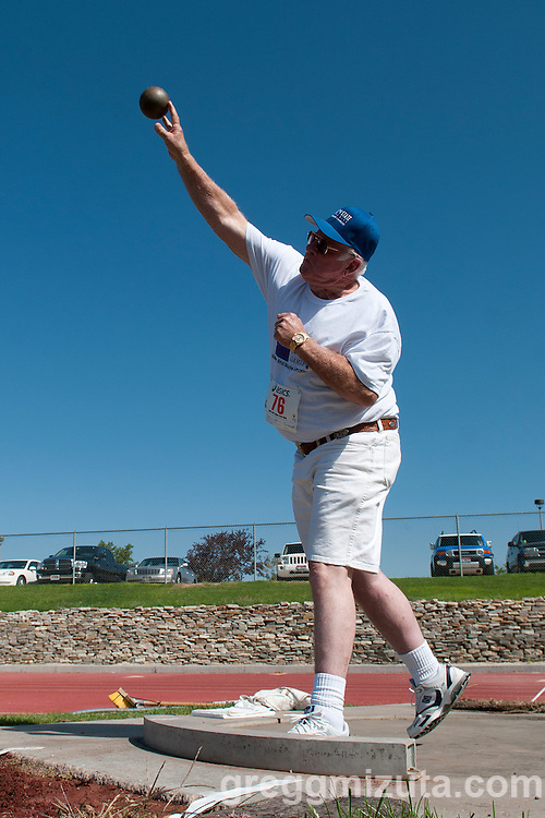 """Todd Triple throws the shot during the 2011 Idaho Senior Games track & field meet at Northwest Nazarene University in Nampa, ID on August 20, 2011. Triple placed second in the mens 75-79 shot put with a mark of 24'06.75"""" (7.49m)."""