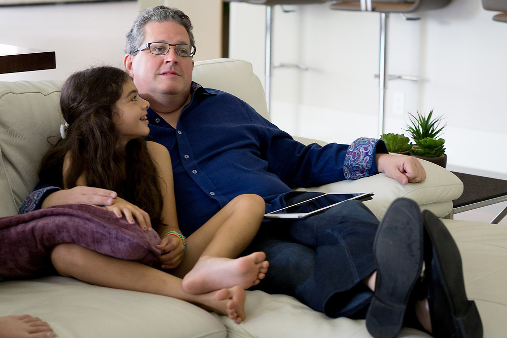 MAY 23, 2015---BOCA RATON, FLORIDA----<br /> The Zietz family sits around watching the show Shark Tank in the Boca Raton house. Morgan, 9 and Sam. Parents Sam and Rachel have instilled in their children the entrepreneurial spirit and it has paid off. Older children Rachel, 14, and her brother Jordan, 13, each has their own business and they're thriving.