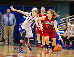 Bridgeport forward Hannah Fetty (10) looks to get around Fairmont Senior center Emily Stoller (23) during a first round game at the Charleston Civic Center.