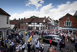 © Licensed to London News Pictures. 10/07/2020. Ditchling, UK. The Battle of Britain Memorial Flight flypast, consisting of a Spitfire and a Hurricane, pass over head as the funeral cortege carrying the body of WWII Forces' Sweetheart Dame Vera Lynn passes through her home village  Ditchling, East Sussex. The cortege will head to a crematorium in Brighton for a private funeral. Photo credit: Peter Macdiarmid/LNP