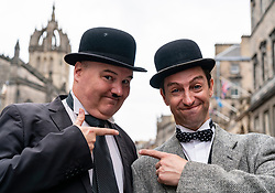 Edinburgh, Scotland, UK; 5 August, 2018. Edinburgh Fringe Festival's first weekend sees thousands of tourists and locals on the Royal Mile  enjoying the free street performers. Pictured; The Laurel and Hardy Cabaret Actors.