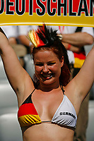 Photo: Glyn Thomas.<br />Germany v Sweden. Second Round, FIFA World Cup 2006. 24/06/2006.<br /> A Germany fan enjoys the warm weather in Munich.