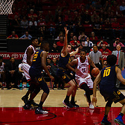 09 December 2017:  The San Diego State men's basketball team hosts the California Golden Bears Saturday afternoon. San Diego State Aztecs forward Matt Mitchell (11) drives the ball into the key against a Cal defender in the second half. The Aztecs lost 63-62 to Cal.<br /> www.sdsuaztecphotos.com