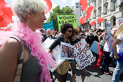 "© Ben Cawthra. 11/06/2011. London, UK. Thousands of Women take to the streets of London today (11/06/2011) to take part in Slutwalk. Slutwalk was started following remarks made by a Canadian police officer, who advised women ""to avoid dressing as sluts"" if they did not want to be harassed Please see special instructions for usage rates. Photo credit should read Ben Cawthra"