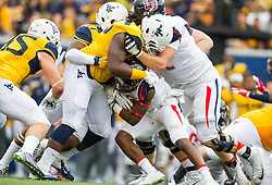 Sep 12, 2015; Morgantown, WV, USA; Liberty Flames running back D.J. Abnar (2) is stopped by West Virginia Mountaineers defensive lineman Christian Brown during the first quarter at Milan Puskar Stadium. Mandatory Credit: Ben Queen-USA TODAY Sports