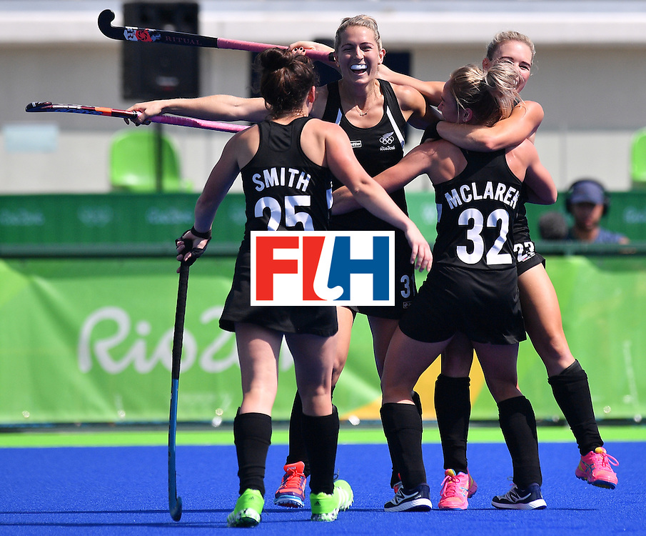 New Zealand's players celebrate a goal during the women's quarterfinal field hockey New Zealand vs Australia match of the Rio 2016 Olympics Games at the Olympic Hockey Centre in Rio de Janeiro on August 15, 2016. / AFP / Carl DE SOUZA        (Photo credit should read CARL DE SOUZA/AFP/Getty Images)