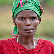 A woman poses for a portait near the dried up water source of Burega Pond, Rulindo District, Rwanda.