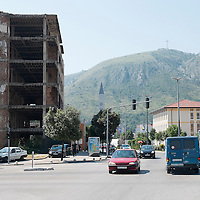 MOSTAR, BOSNIA AND HERZEGOVINA - JUNE 26:  A derelict building near the now called Spansky  Square on  June 26, 2013 in Mostar, Bosnia and Herzegovina.The Siege of Mostar reached its peak and more cruent time during 1993. Initially, it involved the Croatian Defence Council (HVO) and the 4th Corps of the ARBiH fighting against the Yugoslav People's Army (JNA) later Croats and Muslim Bosnian began to fight amongst each other, it ended with Bosnia and Herzegovina declaring independence from Yugoslavia.  (Photo by Marco Secchi/Getty Images)