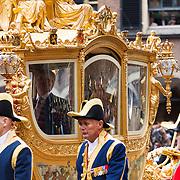 NLD/Den Haag/20130917 -  Prinsjesdag 2013, Koning Willem-Alexander en Koningin Maxima in de gouden koets l