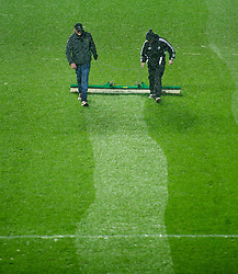 SWANSEA, WALES - Wednesday, January 23, 2013: Groundsmen clear snow from the pitch at Swansea City's Liberty Stadium as snow falls before the Football League Cup Semi-Final 2nd Leg match against Chelsea. (Pic by David Rawcliffe/Propaganda)