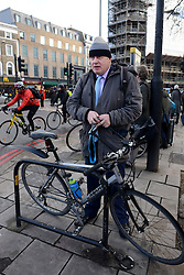 Boris Johnson Tube. London Mayor Boris Johnson arrives by bicycle this morning at King's Cross Station. King's Cross Station, London, United Kingdom. Wednesday, 5th February 2014. Picture by Peter Kollanyi / i-Images