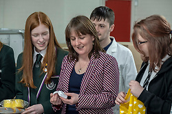 Pictured: Maree Todd withn some of the students who redesigned the box and APS staff<br />