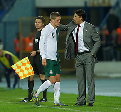 OSIJEK, CROATIA - Tuesday, October 16, 2012: Wales' Steve Morison is substituted by manager Chris Coleman during the Brazil 2014 FIFA World Cup Qualifying Group A match against Croatia at the Stadion Gradski Vrt. (Pic by David Rawcliffe/Propaganda)