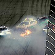 NASCAR Sprint Cup driver Danica Patrick (10)  wrecks after crossing the finish line during the NASCAR Coke Zero 400 Sprint series auto race at the Daytona International Speedway on Saturday, July 6, 2013 in Daytona Beach, Florida.  (AP Photo/Alex Menendez)