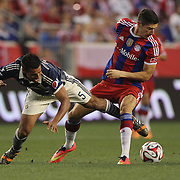 Robert Lewandowski, (right), FC Bayern Munich, challenged by Patricio Araujo, Chivas, during the FC Bayern Munich vs Chivas Guadalajara, Audi Football Summit match at Red Bull Arena, New Jersey, USA. 31st July 2014. Photo Tim Clayton