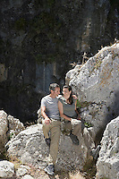 Couple sitting on mountain top elevated view
