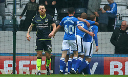 Stuart Sinclair of Bristol Rovers cuts a dejected figure as Matt Done of Rochdale celebrates with teammates after scoring a goal to make it 1-0 - Mandatory by-line: Robbie Stephenson/JMP - 21/10/2017 - FOOTBALL - Crown Oil Arena - Rochdale, England - Rochdale v Bristol Rovers - Sky Bet League One