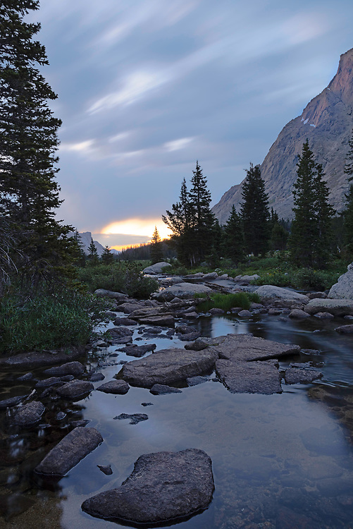 The north fork of the Popo Agie River flows out of Lonesome Lake on an overcast morning, Cirque of the Towers, Wind River Range, Wyoming.