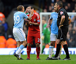 Javier Mascherano with Manchester City's Craig Bellamy during the Barclays Premier League match between Liverpool and Manchester City at Anfield - 21/11/09