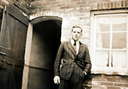 man standing by open door 1940s Netherlands