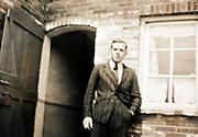 man standing by open door 1940s Netherlands