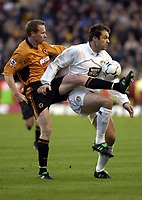 Picture: Henry Browne.<br /> Date: 20/12/2003.<br /> Wolverhampton Wanderers v Leeds United FA Barclaycard Premiership.<br /> Mark Viduka of Leeds is challenged by Jody Craddock of Wolves.
